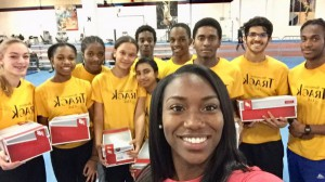 Khamica Bingham Presents New Balance Shoes to BTC Athletes